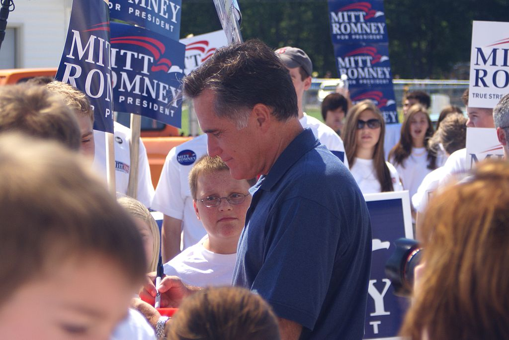 Mitt Romney signing at rally
